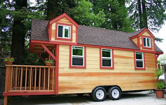 red wood tiny home on trailer